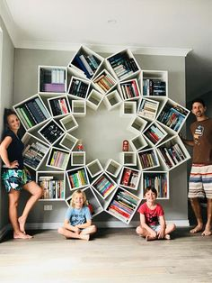 Feast Your Eyes on the Amazing DIY Bookcase This Couple Made for Their Kids It may look complicated, but anyone can do this at home! Creative Bookshelves, Corner Bookshelves, Bookshelf Design, Bookshelf Diy, Bookcases, Decorating Your Home, Diy Home Decor, Decorating Ideas, Diy Furniture