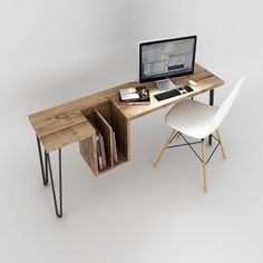 One-High Table--an elegant desk perched on a pedestal inspired by hairpins. A desk of raw wood which reveals a clever drop locker for documents.
