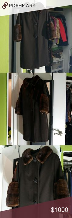 Mink coat Coat with real mink arms and collar. The collar has 2 hidden snap closure if you want to wear high up on your neck. No side pockets. Like new only worn a 3 times. 3 beautiful button closure. Mink Jackets & Coats