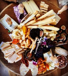 Cheese Board-port derby, triple cream brie, 1000 day gouda, goat cheese, asiago, English cheddar, prairie breeze cheddar, leonara, fresh figs, dried oranges, apricots, marcona almonds, candied almonds, champagne grapes