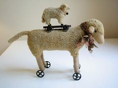 Vintage and beautifully primitive large and small sheep pull toys for the collector of handmade primitive toys