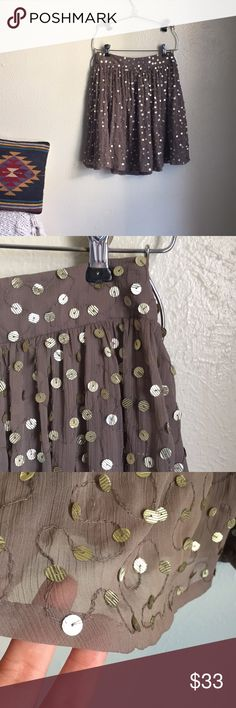 Reiss sequined skirt Reiss flowy sequined skirt. Mauve-y/taupe color with textured soft-gold sequins. Lined with side zip closure. Great condition. Size 0. Reiss Skirts