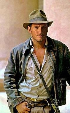 No this is NOT Harrison Ford as Indiana Jones. Look again. This is Chris Pratt in costume as Indiana Jones. I swear I did a double take so fast, I almost sprained my neck. There are rumors abound that Star-Lord himself will be taking over as the treasure hunting archaeologist.