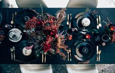 A Wicked, Thrifted Halloween Tablescape. Minus the pumpkins, this could be great as a reception tablescape.