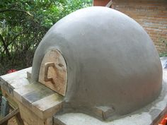 Build Your Own Earth Oven: A Low-Cost Wood-Fired Mud Oven. Buy it from amazon or check it out of your library (like I did lol) very informative :D