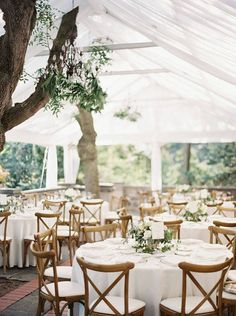All-white tented wedding reception
