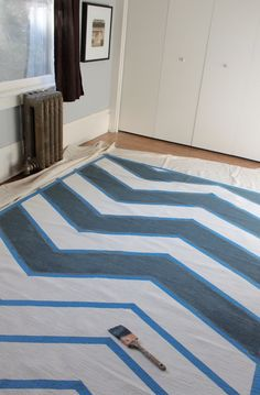 fabric paint a rug with blue tape for patterning