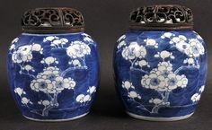 A PAIR OF 19TH CENTURY CHINESE BLUE AND WHITE GINGER JARS painted with flowering prunus. 5ins high.