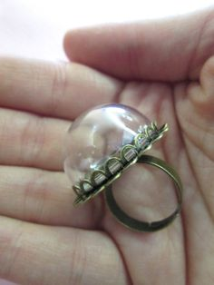 This listing is for one 25mm lace ring and low glass dome. The dome has an 25mm opening and is appox. 18mm high and 25mm wide. The ring is adjustable and will fit most adult ring sizes. You can choose from brass or silver in the drop down menu.  Please know that each glass dome is hand blown and will have slight imperfections.  **This does not include cabochons, sprinkles or dish.** Here are the sweets we carry to make your own ring…