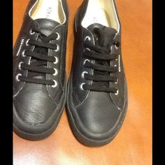 Superga Blk Leather Tennis Slightly worn but great condition. Showing craftsmanship flaw on tip of toe on right shoe you can see the glue a little but not bad unless someone is just starring down at your feet. Superga Shoes