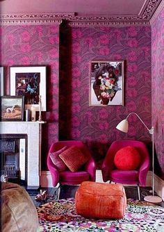 Dark pink living room with art. #fireplace #decor #style #girlie #chair #painting