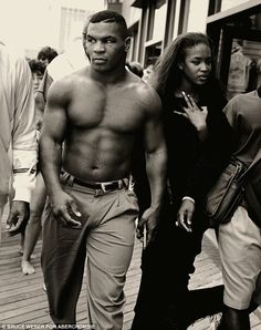 Shots from the volume include British supermodel Naomi Campbell and her then boyfriend boxer Mike Tyson in 1989 by photographer Bruce Weber. The creative claims Tyson was reluctant to pose and only relented after cajoling from his model girlfriend Bruce Weber, Mike Tyson, Star Hollywood, Combat Boxe, Photo Star, Boxing History, Boxing Champions, Vogue Us, Christen