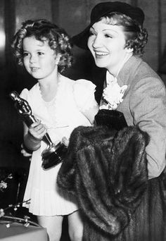 Shirley Temple and Claudette Colbert at the Academy Awards, 1935.