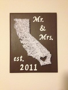 DIY 2year wedding anniversary gift. cotton string art. bought wood board from Walmart $12 then used left over paint I had. painted board then when dry placed outline of Cali printed from computer, taped it and began to nail around outline. lift outline off board and string away!