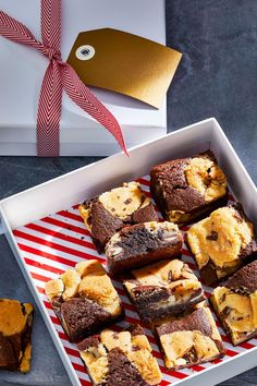 """Mounds of peppermint sugar cookie dough bake into a rich brownie batter to create """"brookies,"""" the brownie-cookie combo you didn't know you needed. #recipe #brownies #holidaydessert #brookie #bhg"""