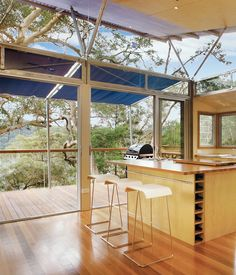 The misconception that prefabricated housing isn't customizable is debunked with the perfect counterexample of this prefab home in the Australian outback on Dangar Island. The separate components of a largely self-sufficient home were assembled quickly and easily; the main rooms of the house are elevated on tall stilts that prevent any damage to the island's indigenous plant life. Photo by Patrick Bingham Hall.