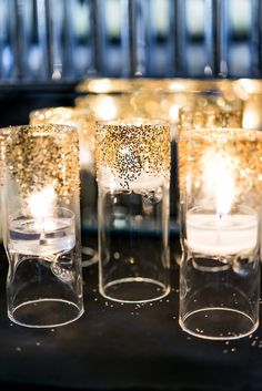 photography from an Art Deco theme party, cute candle holders with just a touch of glitter More