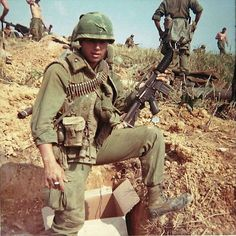 Marine holding a M4 Carbine.