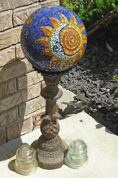 Sun/Moon Gazing Ball, originally uploaded by Gray Dog2007. my 2nd gazing ball-copied a friend's tattoo for the design. It won 1st at the Scott AFB craft show and then won at the Air Mo…
