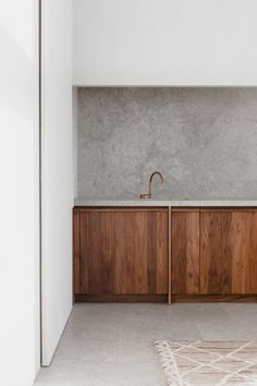 Antwerp apartment with restrained palette based on stone and walnut wood
