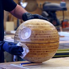 """May the 4th be with you."" Over the years this silly pun has effectively turned today's date into the unofficial Star Wars day, and this year Frank Howarth celebrates it as only he can: By turning a sort of eco-friendly, bamboo plywood version of the Death Star on his lathe."