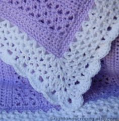 Number 5 in our ten free crocheted baby blanket patterns is this lacy blanket. This pattern uses only basic stitches so it is perfect for the confident beginner.#onecraftygal #craft #crafty #easter #floral #crochet #knitting #quilting #crossstitch #embroidery #paint #decorations #applique #essentialoils #doterra