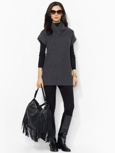 Long layered sweater with boots and leggings