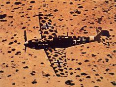 """flying-fortress: """" Messerschmitt Bf-109E-4/Trop flying low over the desert """""""