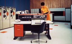 An excellent photograph from the early 1970's of a UNIVAC computer with an attractive female operator.