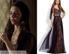 Mary Queen of Scots (Adelaide Kane) wears this black lace gown with mesh sheer pleat sleeves in this week's episode of Reign. It is the Notte by Marchesa Draped Tulle & Lace Gown. Buy it HERE