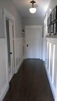 "Paneled Walls, Sherwin Williams paint color ""Front Porch"", Rejuvenation pendant, pocket door."
