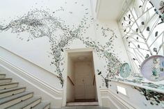 Artist Swirls a Swarm of 10,000 Ceramic Insects Across Gallery Walls