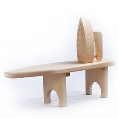 Wooden Toy Ironing Board & Iron for kids is made of unfinished pine in the USA. Small tabletop size is portable, and iron features realistic steam holes on bottom plate!