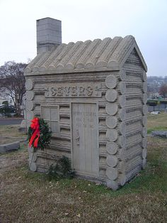 Severs Log Cabin - Front - 1915 by johnncox, via Flickr.  Carved from a single 15 ton block of granite.  The peak of the roof is about eight feet tall. This monument is located in Elmwood Cemetery in Charlotte, NC.