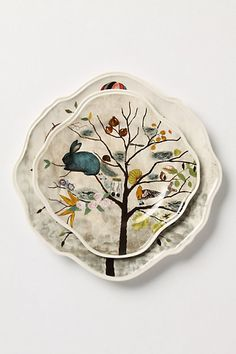 Curious Deciduous Dinnerware #anthropologie  Snippets from Rebecca Rebouche's Flutter Flight and Patch of Shade paintings provide the imaginative print for our curvy, medallion-shaped dinnerware. Stoneware   Dishwasher and microwave safe   Imported