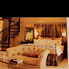 Love the use of the drapes behind the bed. Adds great texture and I think the drapes can be the accent color of the room.