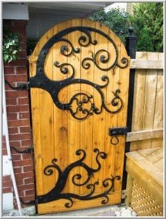 """Beautiful garden gate/door compliments of the blog """"Domythic Bliss"""" at www.domythicbliss.blogspot.com"""