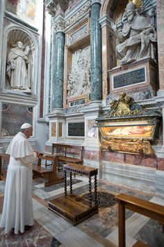 Newly-elected Pope Francis prays at the tomb of Pope St. Pius V in a chapel of the Basilica of St. Mary Major in Rome March 14. 2013 (CNS photo/L'Osservatore Romano)