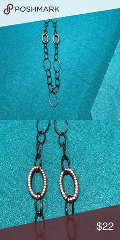 Black with bling long chain necklace Black with two bling discs. Statement layering piece or wear alone. Both sides have bling. Adjustable and well made  🚫No trades ✅ Reasonable offers considered  🚭 Smoke free home Jewelry Necklaces