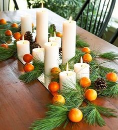 I like using natural elements...oranges, pine cones and pine with white candles....simple yet elegant.