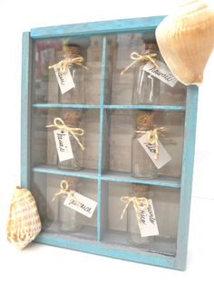 cute way to collect and diplay sand from beaches you've visited this summer using tiny bottles