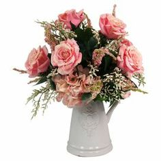 "Faux rose and hydrangea arrangement in a ceramic cameo vase.  Product: Faux floral arrangementConstruction Material: Silk, plastic and ceramicColor: Pink, green and whiteFeatures: Includes faux flowersDimensions: 19.5"" H x 16.5"" W x 19.5"" D"