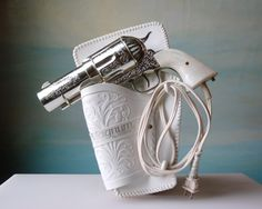 That is the coolest hairdryer I've ever seen.  However, then you'd be pointing a gun to your head...not a pretty picture first thing in the morning
