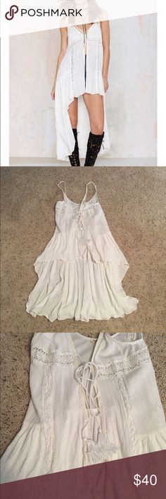 High low tiered top Perfect for any occasion... Especially a concert or light weight outfit. A little shrunken so now fits like an extra small. Can be tied closely shut or kept open with a cute too under neath. Worn twice! Nasty Gal Tops Tank Tops