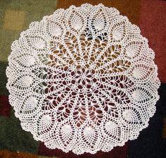 Large round pineapple crochet doily.