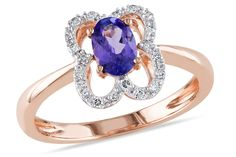 This attractive ring features an oval-cut tanzanite center stone and round white diamond side stones. The fantastic ring is crafted of fine 10-karat rose gold with a high polish finish.