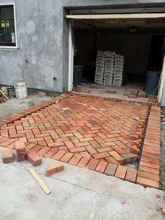 Herringbone Brick Driveway - via Vignette Design: Brick House Brick Driveway, Brick Paving, Driveway Landscaping, Landscaping Ideas, Diy Driveway, Hillside Landscaping, Concrete Patios, Concrete Bricks, Concrete Walkway