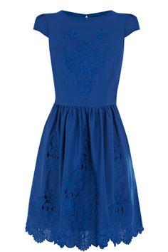 bold blue dress with lace cutouts