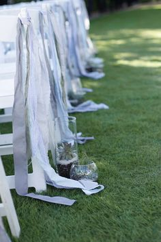 Succulents down the aisle by www.poppiesandhoney.com