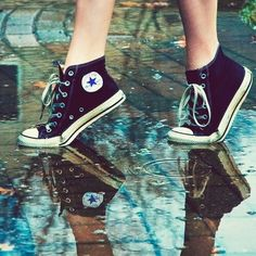 Running in the rain with my converse like I don't care